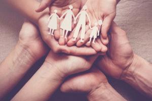 adult children hands holding paper